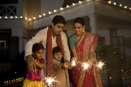 Family with fireworks on Diwali evening Stock Photo