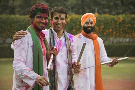 Men playing Holi