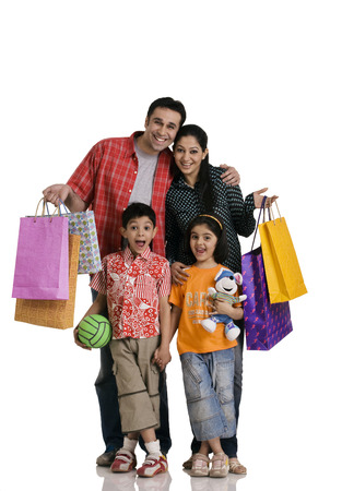 Family with shopping bags Stock Photo - 80311012