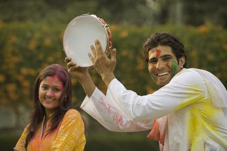 Friends celebrating Holi Stock Photo