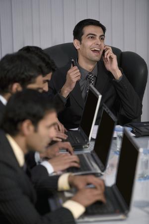 macintosh: Executive working on a laptop Stock Photo