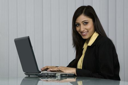 macintosh: Woman working on a laptop Stock Photo