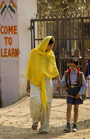 A rural mother picks her child from school