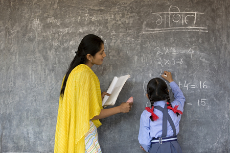 Young girl writing on the board