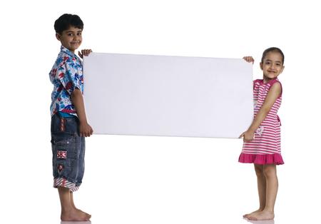 Children holding a whiteboard