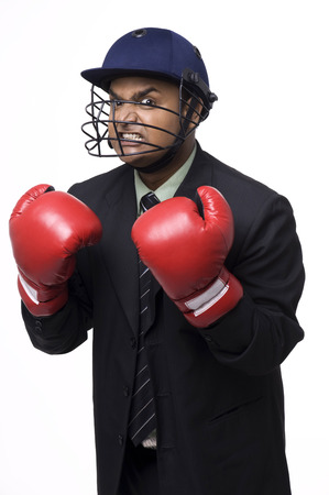 executive helmet: Executive in a helmet and boxing gloves