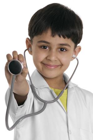 eyecontact: A boy wearing a doctors coat Stock Photo