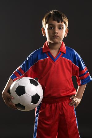 A boy with a football Stock Photo