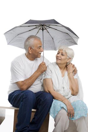Old couple under an umbrella