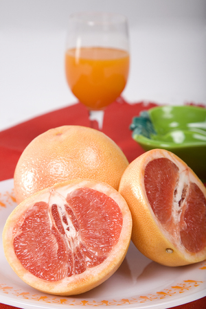 Sliced oranges with a glass of juice
