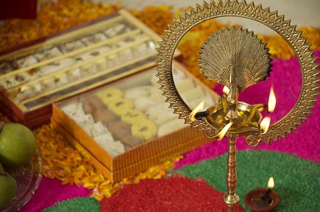 divali: Diya and sweets