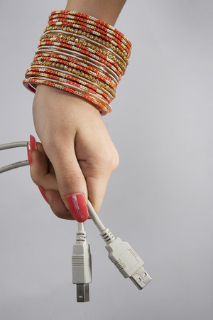 A woman holding plug-ins Stock Photo