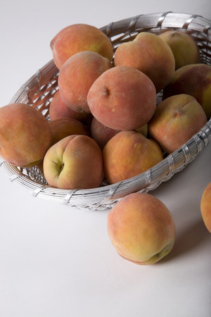 Peaches in a basket Stock fotó