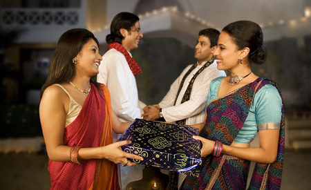 People exchanging gifts on Diwali Stock Photo