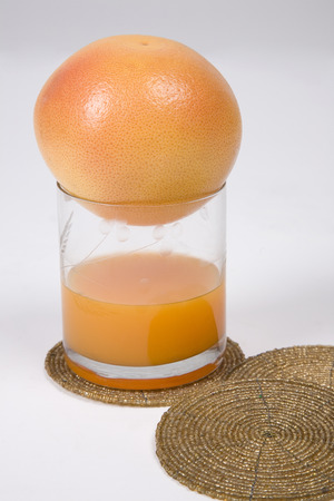 Orange placed on a glass