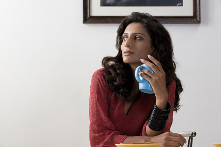 to contemplate: Woman holding a mug