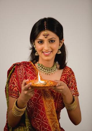 divali: Woman holding a diya