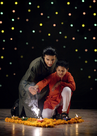 kurta: Father and son burning crackers