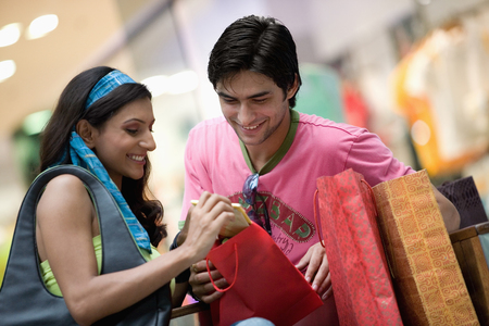 purchase: Couple checking their purchase Stock Photo