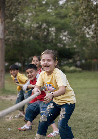 tugging: Children pulling a rope Stock Photo