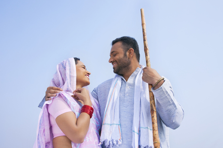 Low angle view of an Indian couple smiling