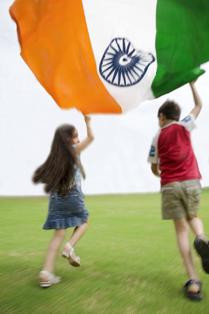 Children running with the Indian Flag