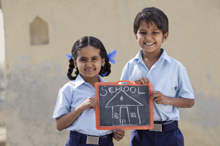 Portrait of happy children holding a slate Stock Photo
