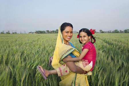 girl in full growth: Portrait of a cheerful mother and daughter in the field