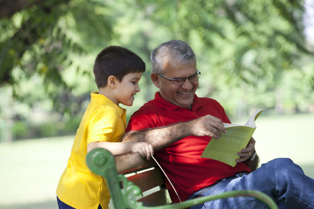 granddad: Grandfather and grandson looking a book