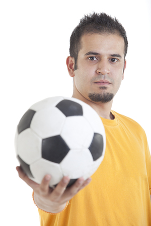 Portrait of young man holding soccer ball over white background Stock Photo