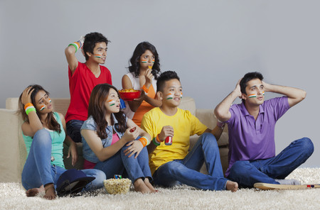 Young friends reacting with disappointment while watching cricket match Stock Photo