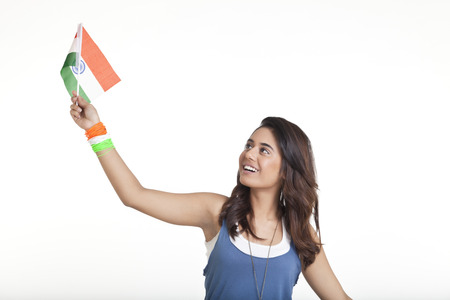 Young woman looking at Indian flag over white background