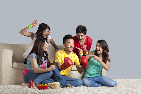 Young friends having fun together at home Stock Photo