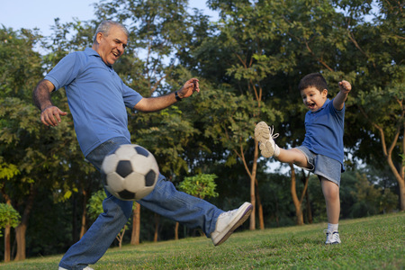 granddad: Grandfather and grandson playing soccer Stock Photo