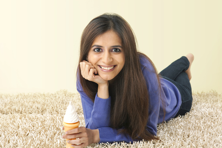 Portrait of a woman holding an ice cream cone
