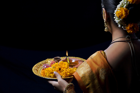 puja: Indian woman performing puja Stock Photo