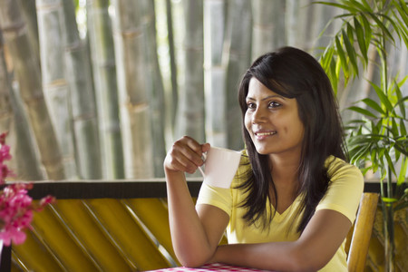 Woman with a cup of tea Stock Photo