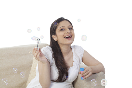 Woman blowing soap bubbles 版權商用圖片