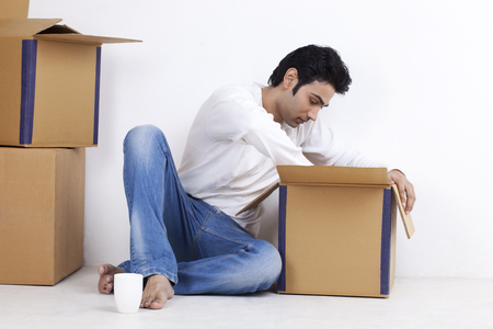 cardboard only: Young man moving into new home