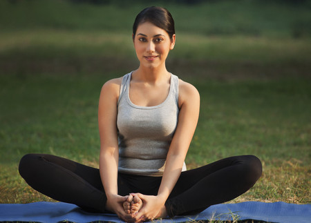 Portrait of young woman doing yoga practice