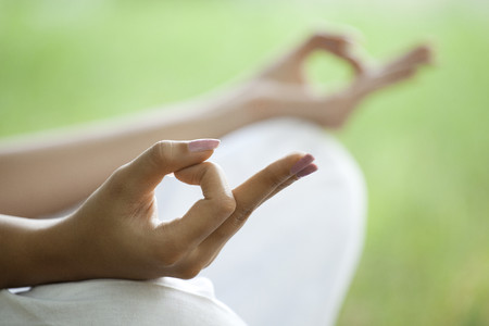 Close-up of young womans hand with yoga gesture called guyan mudra Stock Photo