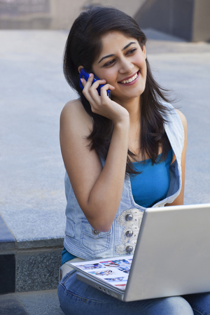 Woman having conversation on mobile phone Stock Photo