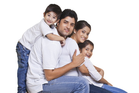 Portrait of happy family over white background Stok Fotoğraf