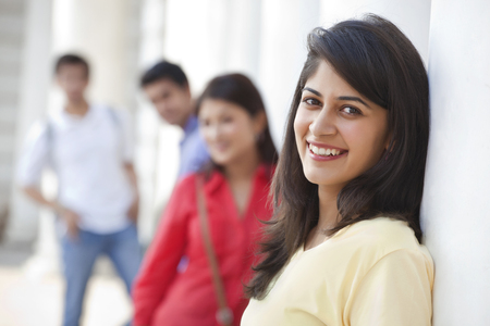 Close-up of woman with friends in the background Stock Photo