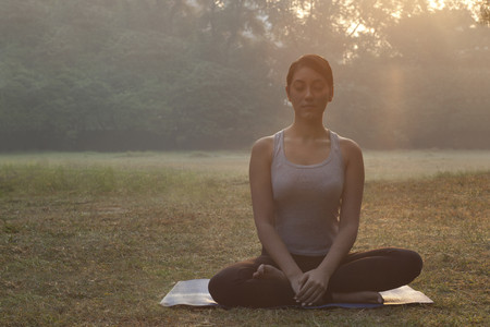 Beautiful young woman doing yoga Stock Photo