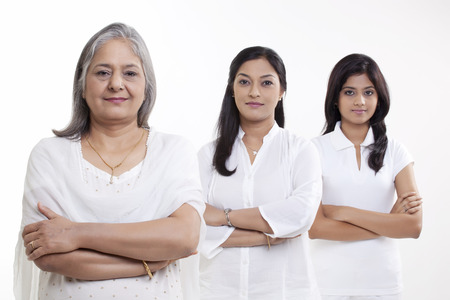 Portrait of multi generation family smiling over white background Stock Photo - 80373360