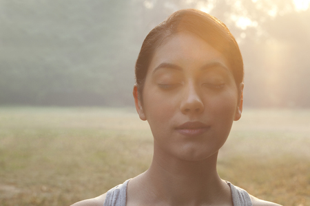 Close-up of young woman with eyes closed Stock Photo