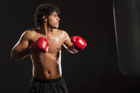 Young male boxer training