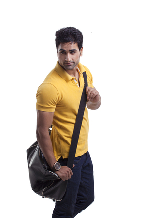 duffel: Handsome young man with duffel bag Stock Photo