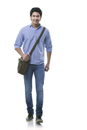 Young man walking over white background Stock Photo